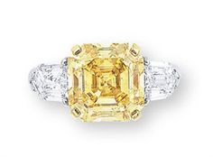 A COLOURED DIAMOND AND DIAMOND RING Set with a square-shaped fancy vivid yellow diamond weighing 6.10 carats, to the shield-shaped diamond shoulders, mounted in platinum and 18k gold | Christie's