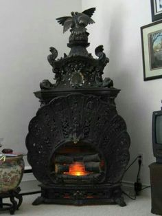 Gothic fireplace  /// Can't tell if electric or gas.  I want a real fire place tho.