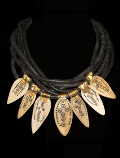 Designed by Melanie | Necklace made from old bone artifacts that were once used by Shamans in Nigeria, are combined with wood/coconut heishi and bronze beads