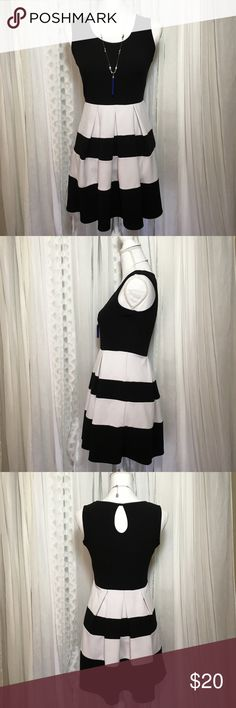 Black and white stripe dress by FINESSE size M Cute feminine dress. Nice stretchy fabric with some texture. Round neck with key hole cut out in back. Dress has wide black and white stripes on skirt. Chest 17 inches Length 30.5 inches 95% polyester 5% spandex If you look closely you can see a few small stains see photo. Only noticeable if looking for them, dress is in nice used condition. Thanks for visiting my closet feel free to look around!🤗 finesse Dresses