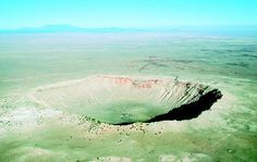 Meteor Crater, also known as Barringer Crater, in Winslow, Arizona, measures nearly a mile wide and 570 feet in depth. There are more than 160 known meteorite craters on the surface of Earth. PHOTOGRAPH REPRODUCED BY PERMISSION OF PHOTO RESEARCHERS, INC.
