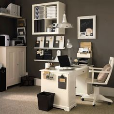 I love a well organized office. I'm intrigued by the clipboard and items on the side of the desk. I think vertical spaces are rarely well used in office space.