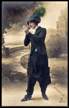 Pants-Skirt, 1900's. She is a clearly a brazen hussy, improper in men's attire and painting her face like a common trollop. Probably one of those shameless suffragettes to boot! You Go Girl!!! <3