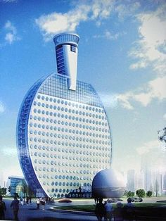Hotel in China shaped like a Ping Pong paddle... with the Ping Pong ball laying in front of it... This is cool...