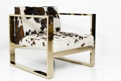 I am IN LOVE w this cowhide print chair!!