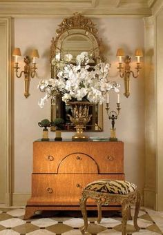 console, tiger stool, sconces, mirror and floor are charming together