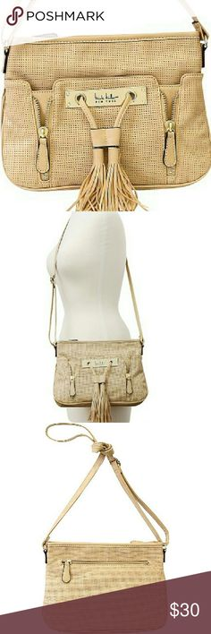 Nicole Miller Crossbody A PVC perforated distressed suede east west crossbody with top zip closure and faux drawstring and hardware Nicole Miller plaque detail. Top zip closure. Adjustable crossbody strap with a drop length of 24 inches. Back exterior features one zipper pocket. Lined interior features one zipper pocket and two slip pockets. Distressed Perforated suede PVC. Polyester lining. 2 front zipper details. Pretty snakeskin pattern lining. Stock photos used, last is actual product…