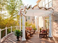 A classic outdoor structure, the pergola, provides a shaded spot for this seating area. Woody vines are trained over the latticework to create an elegant atmosphere. Photo courtesy of Trex