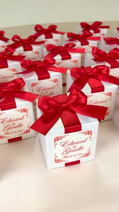 Personalized wedding favor gift boxes with red satin ribbon bow and names. Elegant party bonbonniere for candies or small souvenirs to thank guests. #welcomebox #giftbox #personalizedgifts #partyfavor #weddingfavor #weddingbox #weddingfavorideas #bonbonniere #weddingparty #sweetlove #favorboxes #candybox #burgundywedding #ivorywedding #redwedding #uniqueweddingfavor