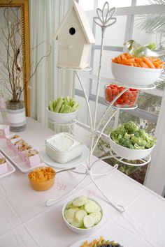 a plant stand to hold the goodies, clever!   I could see this get toppled over at my house. cute idea  maybe not as tall