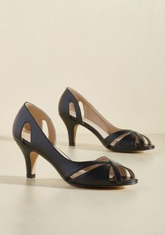 <p>Show you're completely in step with your classic sensibilities by wearing these black heels! Their faux-leather, d'Orsay-inspired silhouettes feature keyholes on the counters and crisscrossing straps on the open toes, creating a retro-chic look that was worth the wait.</p>