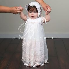 The Joli Pink Christening Romper Dress is an elegant full length heirloom Christening Dress.  Designed with 100% cotton and an embroidered netting with a floral pattern. A beautiful heirloom christening dress for your little one.