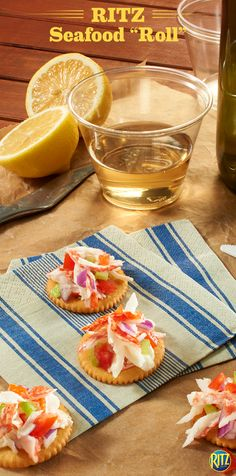 """This RITZ cracker Seafood """"Roll"""" is a delicious snack for those lazy summer afternoons. Top a Garlic Butter RITZ cracker with deli crab meat and chopped tomatoes. It's so versatile — use any of your favorite RITZ Cracker varieties and/or your favorite salad, like tuna, lobster, mixed seafood, or chicken."""