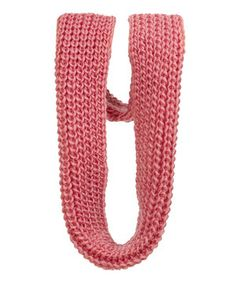 Indulge in the perfect blend of warmth and chic style by easily draping this knit infinity scarf along the neckline.