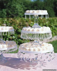 Glass cake stands sparkle with bands of beads used for chandeliers.