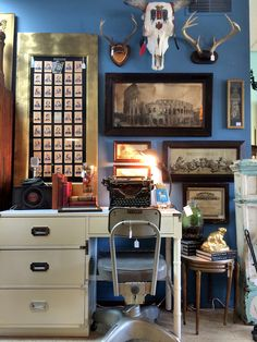 Mid Century Dixie Campaigner Desk, Industrial Desk Chair, Antique Cast Iron Gooseneck Desk Lamp, Antique Typewriter, Retro Radio & Mic, Old Authors Game Playing Cards Framed in Savaged Wardrobe Door (Both From The Carrick Estate - The Carrick House, Lexington KY), Antique Rome Colosseum Photograph Prints, Cow Skull & Deer Antlers, Antiques Books, Mid Century Nesting Side Tables, Golden Beaver and More!