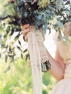 A wrap similar to this with burlap ribbon going up the stems and then I wrap the lace up and tie off in a bow with tails..