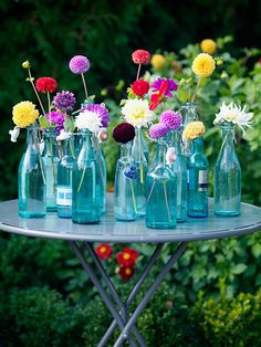 I love flowers in bottles - this is a brilliant idea for a party indoors or out.