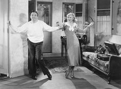 Still sitting pretty Ginger Rogers and Jack Haley kick up their heels in this scene in Sitting Pretty a film released by Paramount Pictures in 1933