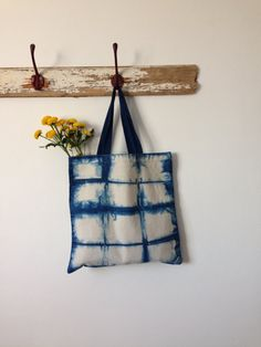 This unbleached organic cotton bag has been hand dyed using natural indigo. The abstract grid has been created using the Japanese resist dying