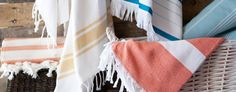 Turkish towels laid artfully across basket. The use of color brings out texture...