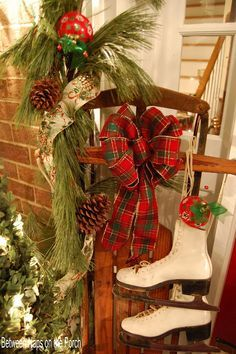 Simple Vintage Christmas Entryway Decoration With Green Garland And Pine Cone And Green And Red Ribbon Ornament Along With White Ice Skating Shoes And Also Red Ball Ornament Primitive Christmas, Tartan Christmas, Noel Christmas, Country Christmas, Winter Christmas, Vintage Christmas, Christmas Wreaths, Christmas Crafts, Vintage Sled
