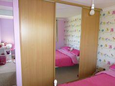 Custom wardrobe with sliding mirror doors