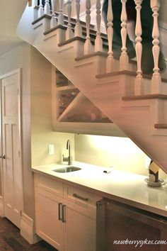 wet bar under stairs  at fourth avenue blog watermark Custom built in the Basement Remodel