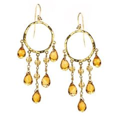 LET THERE BE LIGHT    Chandelier earrings in 18k gold with citrine; $1,250; Jolie B. Ray Designs, Chappaqua, N.Y.; 914-772-5465; joliebray.com