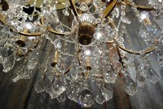 This modern chandelier from Crystorama is a part of the Filmore collection and comes in a antique gold finish