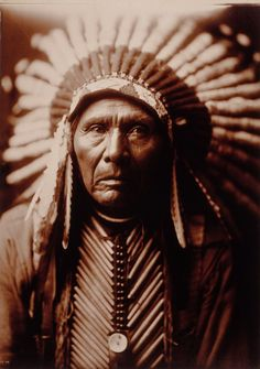 Three Horses, Native American, photographed by Edward Curtis in 1905. Three Horses, head-and-shoulders portrait, facing front, wearing headdress.