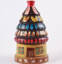 Adorable Hansel and Gretel nesting matryoshka gingerbread house made in Poland. The fairy tale house is wooden and probably hand painted. You