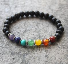 At Lovepray jewelry we specialize in chakra bracelets. About six years ago, we made our first chakra healing bracelet, which had the seven chakras, one genuine gemstone representing each chakra and the rest was genuine ebony to give it . Chakra Jewelry, Chakra Bracelet, Diy Bracelet, Beaded Jewelry, Jewelry Bracelets, Handmade Jewelry, Jewellery, Silver Bracelets, Necklaces