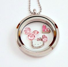 Hello Kitty living locket, floating locket, memory locket.  Like Origami Owl