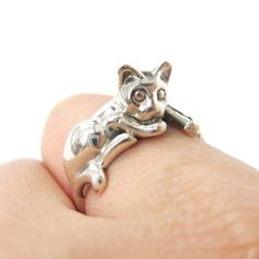 - Details - Sizing - Shipping An animal ring made in the shape of a realistic kitty cat in sterling silver! The cat is laid across your finger with its tail wrapped around to form the band! Also avail