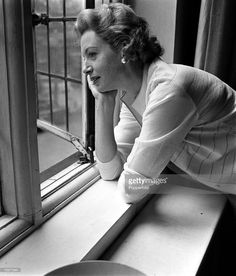 England, 1956, British actress Deborah Kerr is pictured looking out of an open window