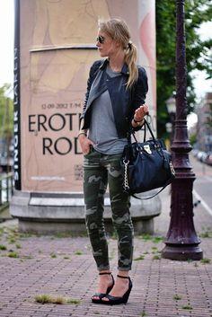 Shop this look on Lookastic:  https://lookastic.com/women/looks/biker-jacket-crew-neck-t-shirt-skinny-jeans-wedge-pumps-tote-bag-sunglasses-bracelet-ring/12714  — Black Sunglasses  — Black Quilted Leather Biker Jacket  — Black Ring  — Black Bracelet  — Black Leather Tote Bag  — Grey Crew-neck T-shirt  — Dark Green Camouflage Skinny Jeans  — Black Leather Wedge Pumps