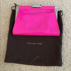 Michael Kors hot pink patent clutch Authentic Michael Kors clutch in a gorgeous and vibrant pink patent leather. Some light marks on the outside as seen in the photo but price reflects. Still an awesome statement piece! Michael Kors Bags Clutches & Wristlets
