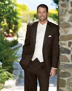 it's really upsetting me how everyone is telling me how ugly brown tuxes will be. 1. it's my wedding 2. i think they're mistaking it with like the nasty 80s brown tuxes 3. this guy looks great in it.