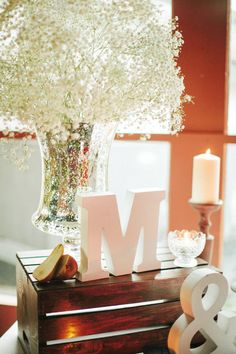 Vignette with Initials & Baby's Breath | See the wedding on SMP - http://www.StyleMePretty.com/2014/01/08/grand-geneva-resort-wedding/ Carly McCray Photography