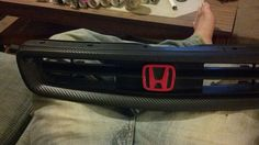 Black carbon fiber with red Honda grill