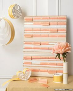 Create a beribboned bulletin board by using ribbons and fabric strips in assorted colors and patterns to cover the surface of a piece of plywood.