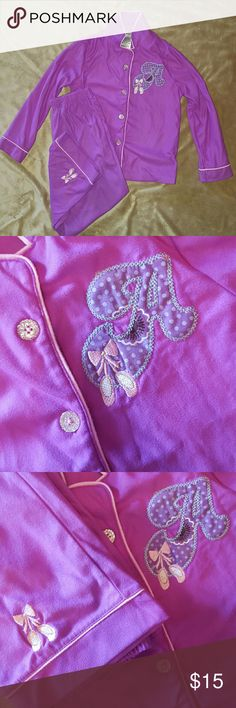 "2 PC Girls pajama set with embroidered ""A"" Girls purple pajama set with embroidered ""A"" and ballerina shoes.  Embroidered ""A"" is on the left side of the long sleeve top and embroidered ballerina shoes are on the bottom of the left pant leg; 100% polyester;  Size S/CH (6/6X) Komar Kids Pajamas Pajama Sets"
