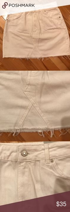 TOPSHOP NWT White Denim Skirt New TOPSHOP white denim skirt with tags attached. Size 10. Bottom has frayed edge. Runs small. Topshop Skirts Mini