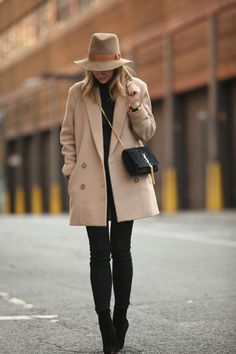 Brooklyn blonde black look and camel coat