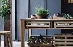 The SKOGSTA range features thisA bar table in solid acacia along with storage crates from the range.