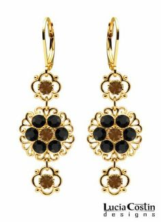Lucia Costin Dangle Earrings Embellished with 4 Petal Lovely Flowers, Filigree Elements, Black and Brown Swarovski Crystal Accents; 14K Yellow Gold over .925 Sterling Silver; Handmade in USA Lucia Costin. $63.00. Update your everyday style with inspiration when wearing this piece of jewelry. Lucia Costin floral dangle earrings. Unique jewelry handmade in USA. A perfect feminine touch. Enhanced with black and topaz Swarovski crystals