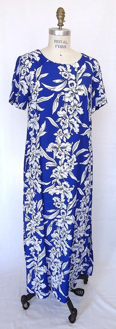 A rayon muumuu dress. Available in blue or black. Side slits on both sides. Exclusive: Fabric design exclusive to Classic Hawaii Designs Material: 100% rayon Care: Machine Wash cold. Tumble dry low Click on image for enlarged view.