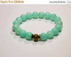 Beautiful Light Green Jade  gemstones with a brass focal bead.   • This is the perfect everyday bracelet.    • Wear this alone or layer with other bracelets for that bohemi... #stretchy #trendy ➡️ https://www.etsy.com/listing/508347397/sale-boho-bracelet-gemstone-stretch?utm_campaign=products&utm_content=c53c87ca24834d1aba63d04939032669&utm_medium=pinterest&utm_source=sellertools