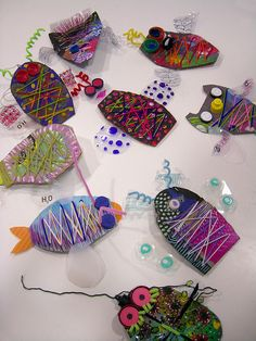 Sewing or weaving on cardboard fish insects yarn wrapping